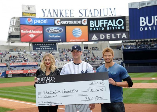 Buffalo David Bitton Spokespeople Kellan Lutz And Tori Praver Present A Check To The New York Yankees Foundation On Behalf Of The Brand