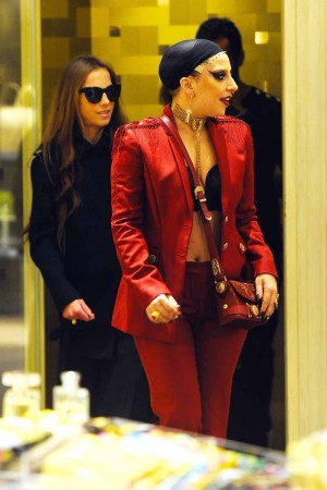 Lady Gaga (in red) and Allegra Versace (in black)
