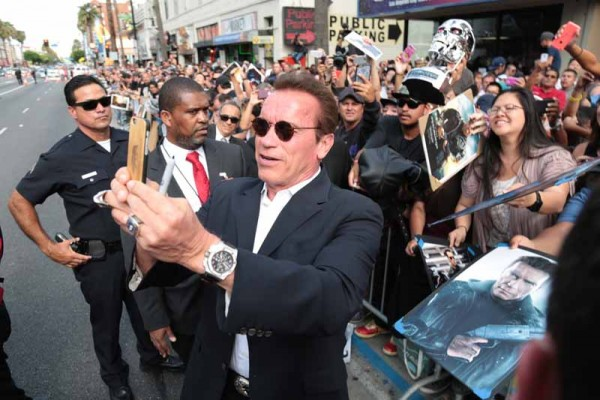 "Arnold Schwarzenegger takes a selfie with fans as Paramount Pictures presents the Los Angeles premiere of ""Terminator Genisys"" at the Dolby Theatre in Los Angeles, California on Sunday, June 28, 2015.  (Photo: Alex J. Berliner/ABImages)"