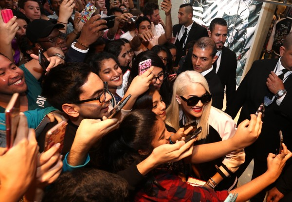 DUBAI, UNITED ARAB EMIRATES - FEBRUARY 10:  Rita Ora poses for pictures with fans as she launches her adidas Originals Rita Ora SS16 collection at the Originals store at Dubai Mall on February 10, 2016 in Dubai, United Arab Emirates.  (Photo by Warren Little/Getty Images) *** Local Caption *** Rita Ora